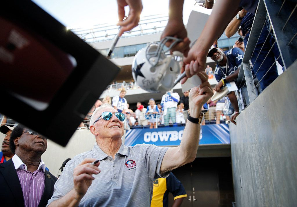 Dallas Cowboys owner and general manager Jerry Jones gives out his autograph to fans before making it to the field before the Hall of Fame Game between the Dallas Cowboys and Arizona Cardinals at Tom Benson Hall of Fame Stadium in Canton, Ohio on Thursday, August 3, 2017. Jones will be inducted into the Pro Football Hall of Fame this weekend.  (Vernon Bryant/The Dallas Morning News)