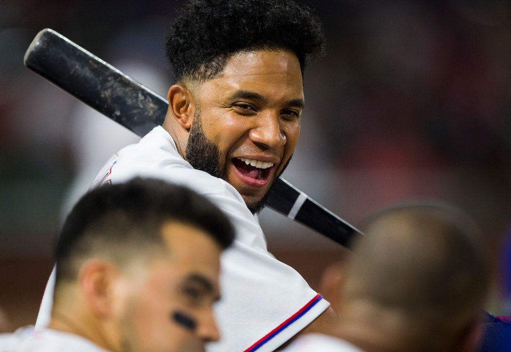 Texas Rangers shortstop Elvis Andrus (1) jokes with his team mates in the dugout during the eighth inning of an MLB game between the Texas Rangers and the Oakland Athletics on Thursday, July 26, 2018 at Globe Life Park in Arlington, Texas. (Ashley Landis/The Dallas Morning News)