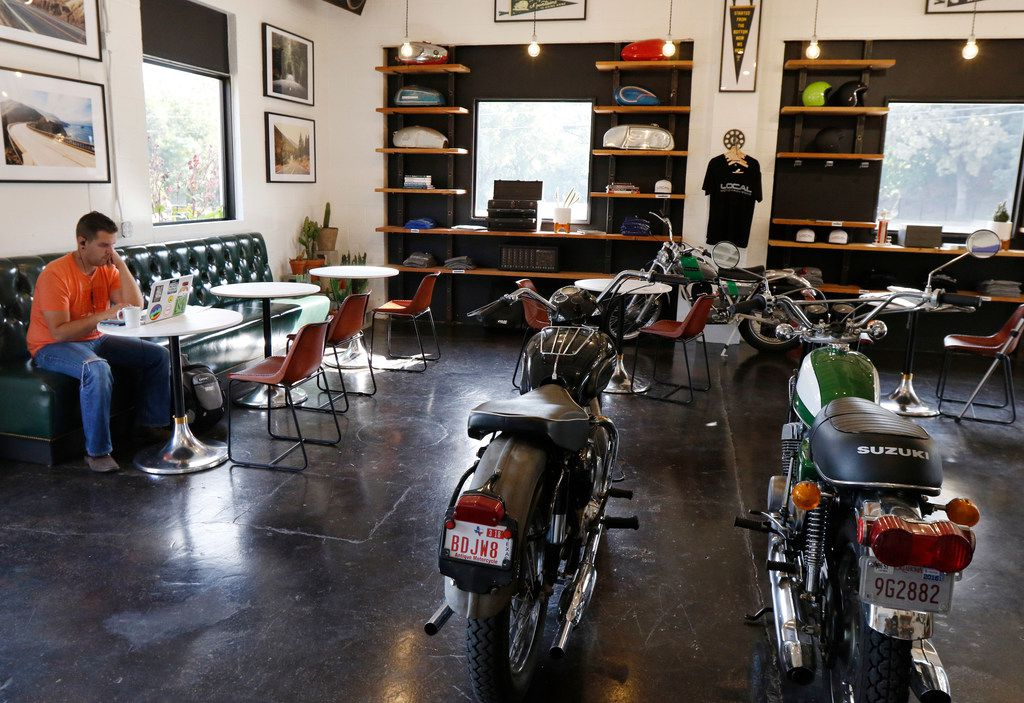 Josh Cogan of Dallas relaxes at Local Moto + Provisions, a vintage motorcycle repair shop that serves as an extension of Local Press in Dallas. They support local vendors while creating farm to bottle cold-pressed, organic juices served in glass bottles + classic coffee & espresso drinks. Photo taken on Monday, September 25, 2017. (David Woo/The Dallas Morning News)