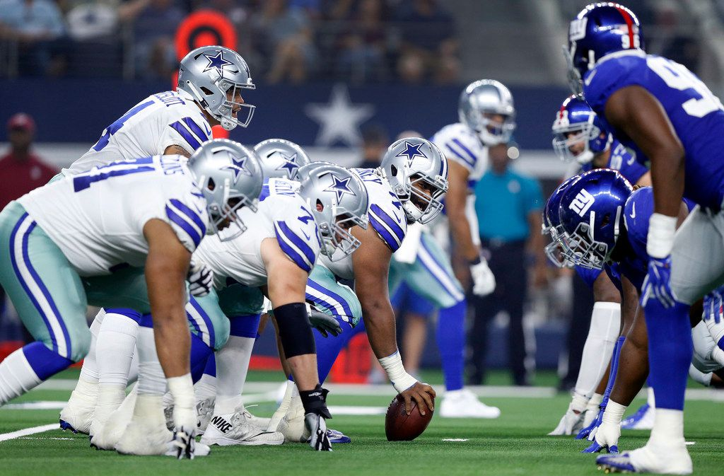 FILE - Dallas Cowboys center Joe Looney (73) and the offensive line square off against the New York Giants during the second quarter at AT&T Stadium in Arlington, Texas, Sunday, September 16, 2018. (Tom Fox/The Dallas Morning News)