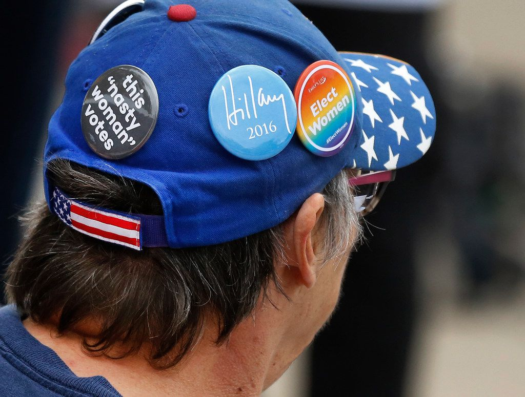 Political buttons adorn the hat of a woman at the early voting site at Lakeside Activity Center in Mesquite, Texas, photographed Tuesday, October 30, 2018. (Louis DeLuca/The Dallas Morning News)