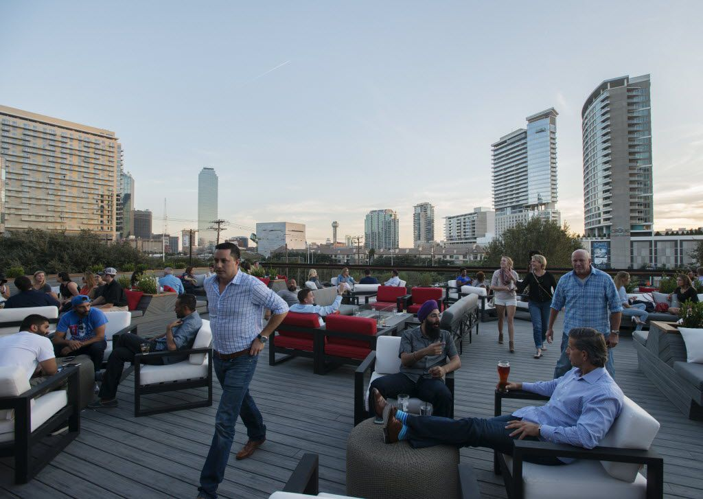 Soak up 360-degree views of downtown Dallas and Victory Park from Happiest Hour's rooftop terrace.