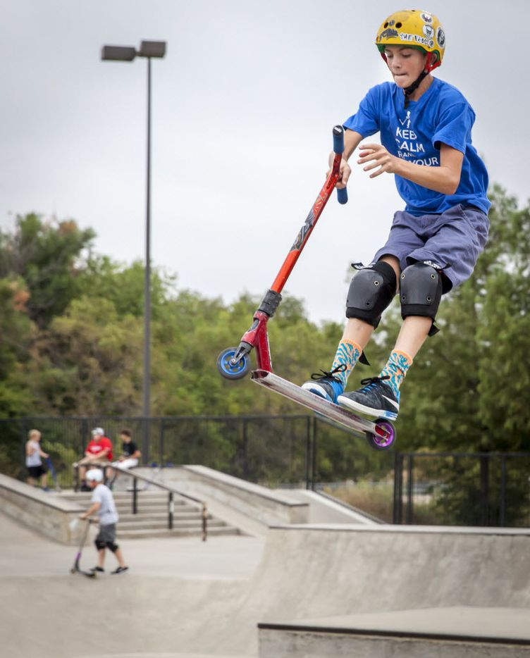 Johnny Shaffer rides his scooter during family night at The Edge Skate Park in Allen. Many Dallas skateboarders also head to Allen to use the city's park. (2015 File Photo/The Dallas Morning News)