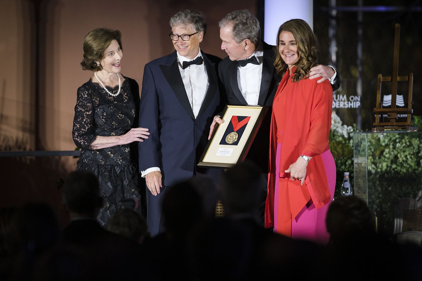 Bill and Melinda Gates receive the George W. Bush Medal for Distinguished Leadership award from President George W. Bush and Laura Bush during the George, W. Bush Presidential CenterÕs 2019 Forum on Leadership Gala at the Rosewood Mansion on Turtle Creek on Thursday, April 11, 2019, in Dallas. (Smiley N. Pool/The Dallas Morning News)