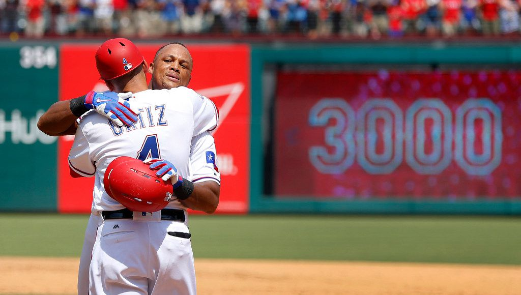 Texas Rangers Adrian Beltre receives a congratulatory hug from first base coach Hector Ortiz (4) after hitting his 3,000th career hit in the fourth inning against the Baltimore Orioles on Sunday, July 30, 2017 at Globe Life Park in Arlington, Texas. (Tom Fox/Dallas Morning News/TNS)  NO MAGAZINE SALES MANDATORY CREDIT; NO SALES; INTERNET USE BY TNS CONTRIBUTORS ONLY