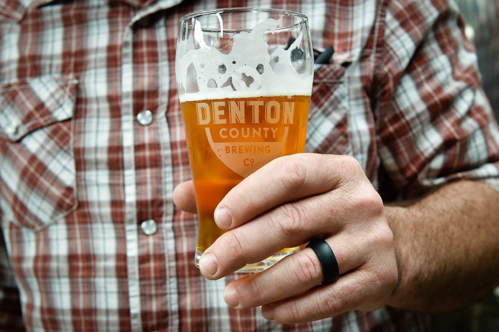 Owner Seth Morgan holds a cold beer at Denton Brewing Co.  Owners are Jenny and Seth Morgan -- and this is Seth's passion project. He has brewed for more than 20 years, and quit his high paying bank job to pursue this project.