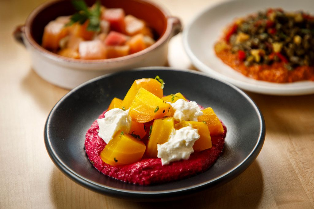 Meze, which are tapas-size bites, come in numerous variations, including (clockwise from bottom) yellow beets with red beet hummus, oregano and labneh; pickled turnips with red lentil puree and roasted shallot; and French lentils, muhamarra, red peppers and walnuts.