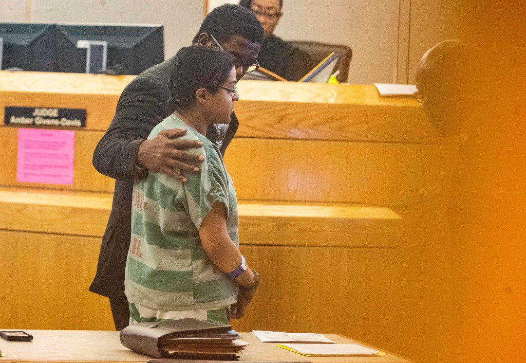 Heath Harris escorted his client, Sini Mathews, to her seat during a bond reduction hearing in January at the Frank Crowley Courts Building.