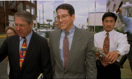 Former council member Paul Fielding (center) walked out of federal court with his attorney Chuck Meadows ( left) on  June 27, 1996, in Sherman.
