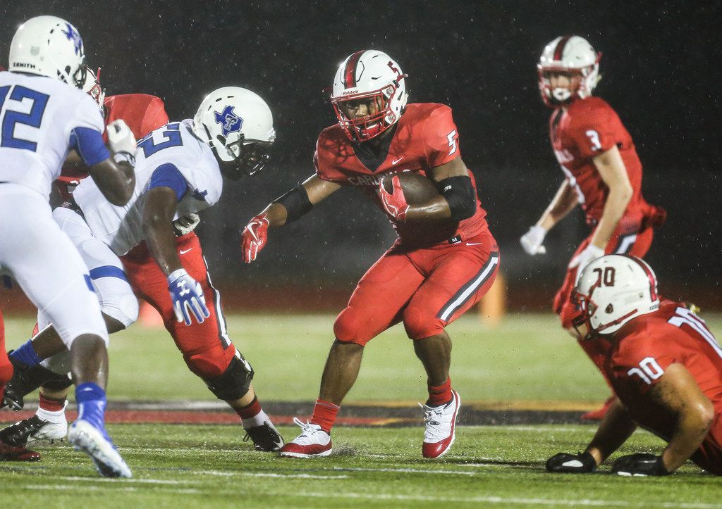 Melissa running back Ja'Bray Young (5) works to break past the Trinity Christian defensive line during a matchup between the Melissa Cardinals and the Trinity Christian-Cedar Hill Tigers on Thursday, Sept. 20, 2018 in Melissa, Texas. (Ryan Michalesko/The Dallas Morning News)