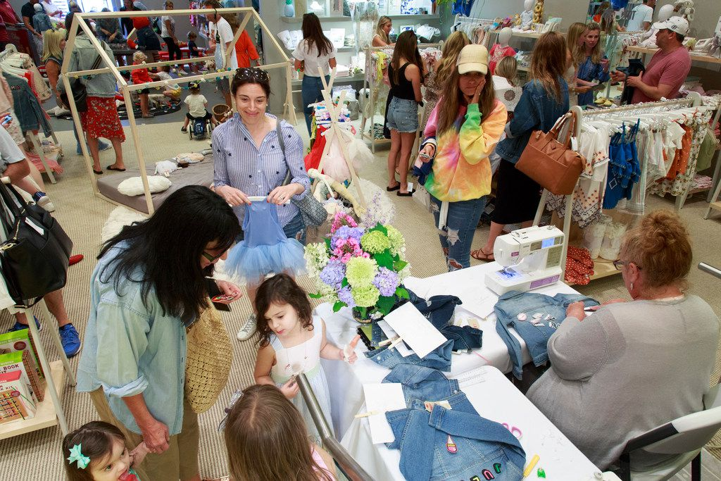A mommy and me event to embellish Levis blue jean jackets at The Tot's pop-up shop in The Hamptons in New York, summer 2018.