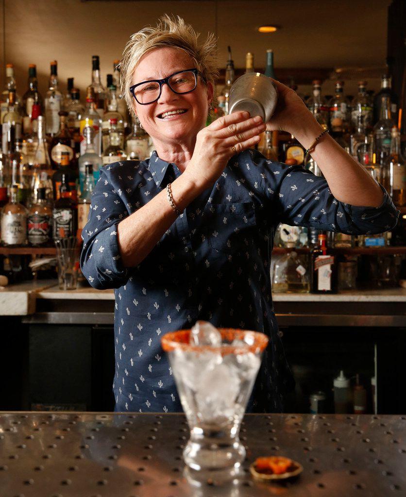 Leann Berry, mixologist at The Cedars Social, makes a sicar cocktail.