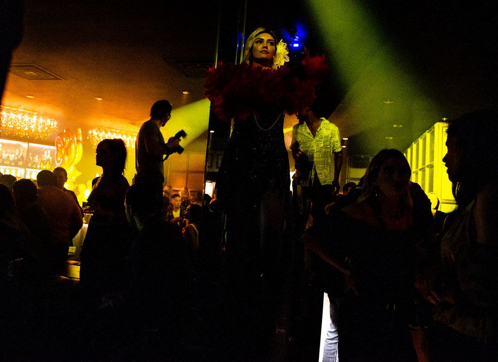Kali Mikelson dresses as a flapper as she dances on the counter at One Sette in Dallas on Friday, October 12, 2018. (Shaban Athuman/The Dallas Morning News)