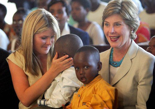 Laura Bush, with daughter Jenna and Rwandan children in Kigali, went on an official visit to Africa after a meeting of the G8 leaders in Gleneagles, Scotland in 2005.