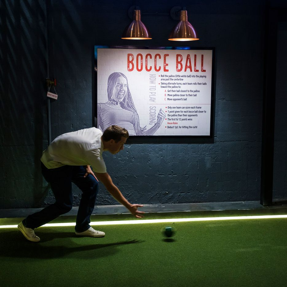 Josh Winkler plays bocce ball at Sidecar Social during its soft opening.