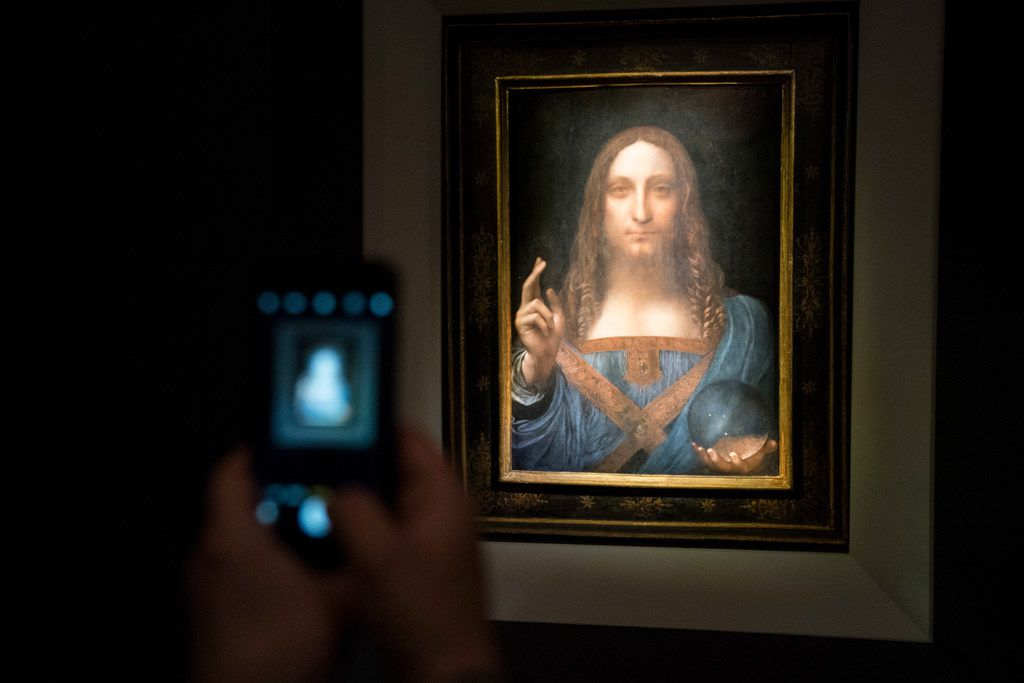 A visitor took a photo of the painting Salvator Mundi by Leonardo da Vinci at Christie's New York Auction House in November 2017 in New York City.