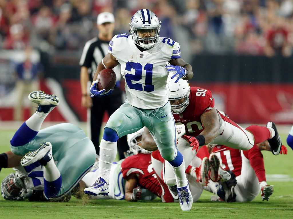 Dallas Cowboys running back Ezekiel Elliott (21) runs up the field after passing by Arizona Cardinals defensive tackle Robert Nkemdiche (90) during the second half of play at University of Phoenix Stadium in Glendale, Arizona on Monday, September 25, 2017. Dallas Cowboys defeated the Arizona Cardinals 28-17. (Vernon Bryant/The Dallas Morning News)