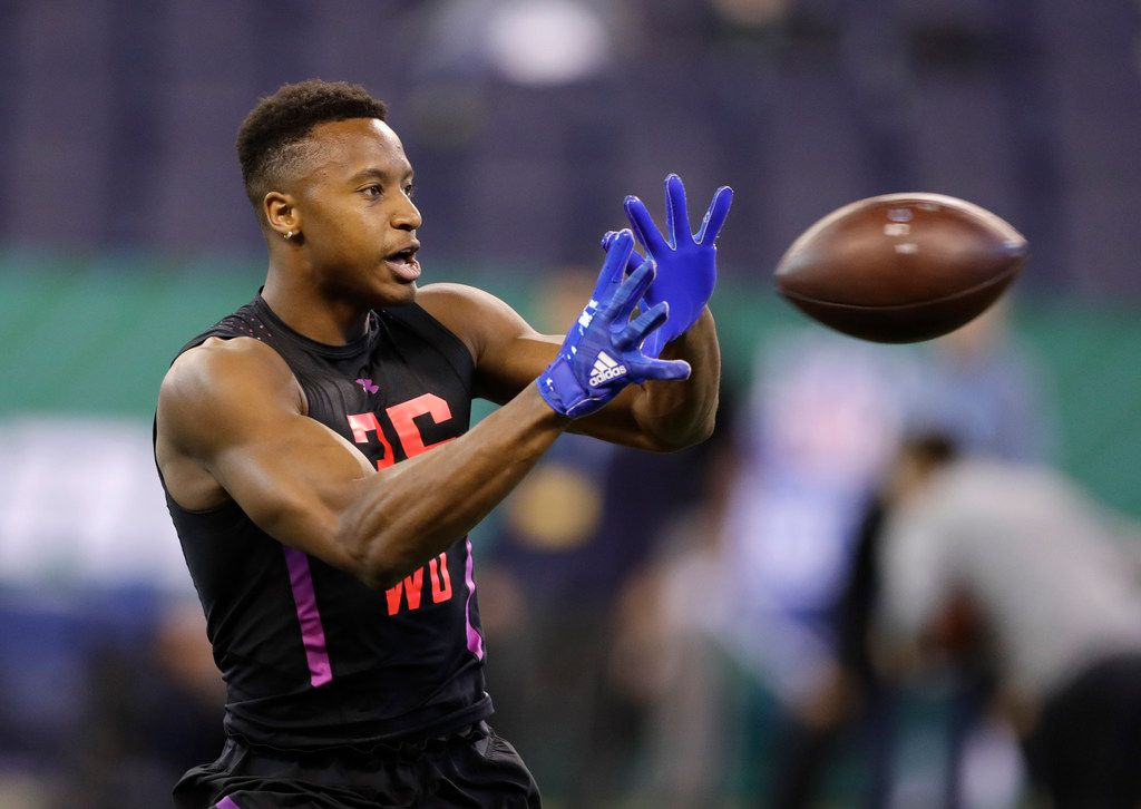 SMU wide receiver Courtland Sutton runs a drill during the NFL scouting combine on Saturday, March 3, 2018, in Indianapolis. (AP Photo/Darron Cummings)
