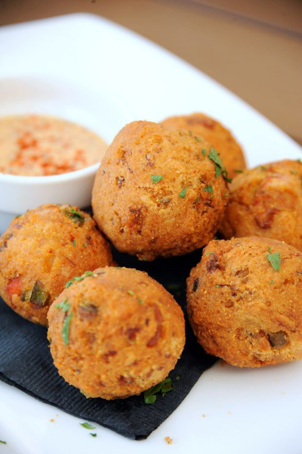 Lobster jalapeno hush puppies come with creole mustard aioli sauce.