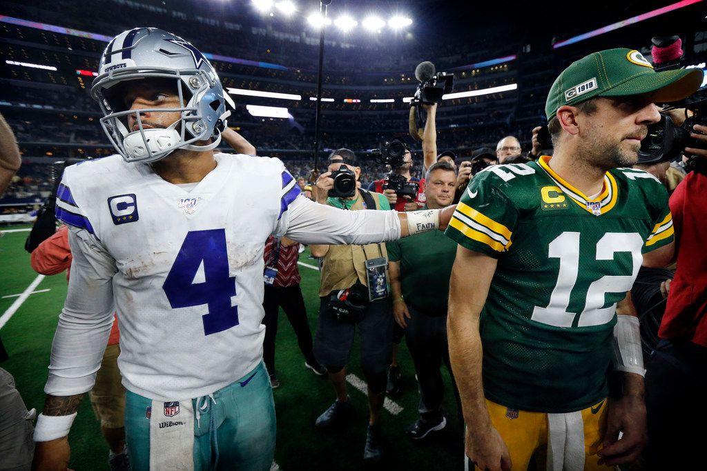 Cowboys quarterback Dak Prescott (4) congratulates Packers quarterback Aaron Rodgers (12) after Dallas' 34-24 loss at AT&T Stadium in Arlington on Sunday, Oct. 6, 2019.