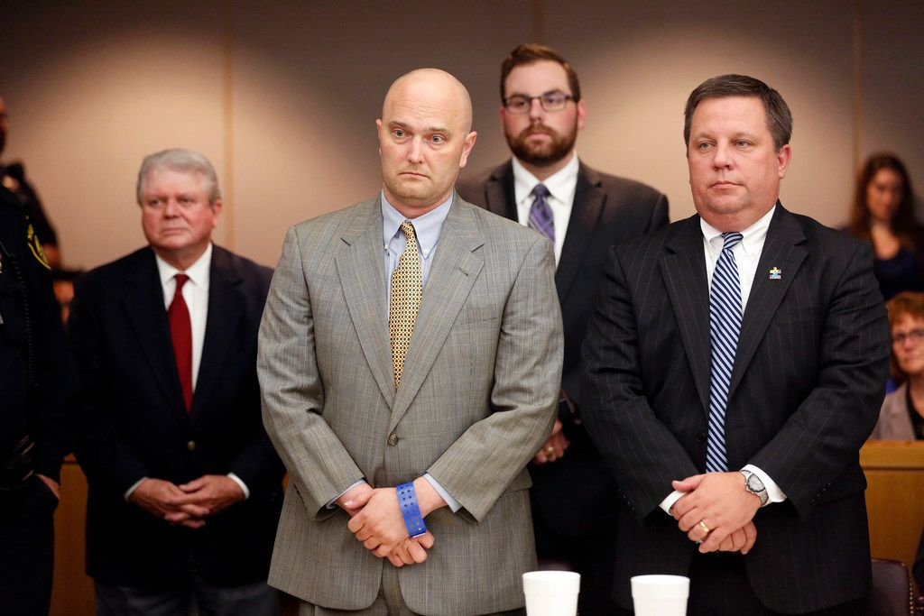 Roy Oliver (center), standing with his attorney Miles Brissette, listens to the judge deliver his sentence Wednesday night. (Rose Baca/Staff Photographer)