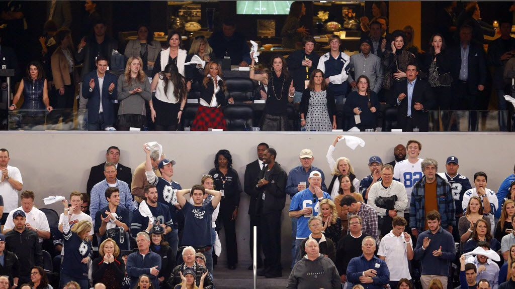 Fans cheer from the owners suite after the Dallas Cowboys scored against the Detroit Lions in the fourth quarter of the NFC wild card game at AT&T Stadium in Arlington in January 2015.