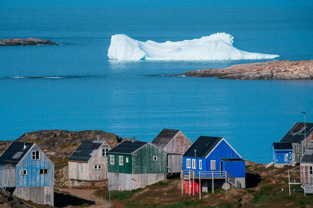 Icebergs float behind the town of Kulusuk in Greenland. President Donald Trump's interest in buying Greenland has been met with disdain, but it follows a longstanding U.S. tradition of expanding its frontiers through land purchases from foreign countries.