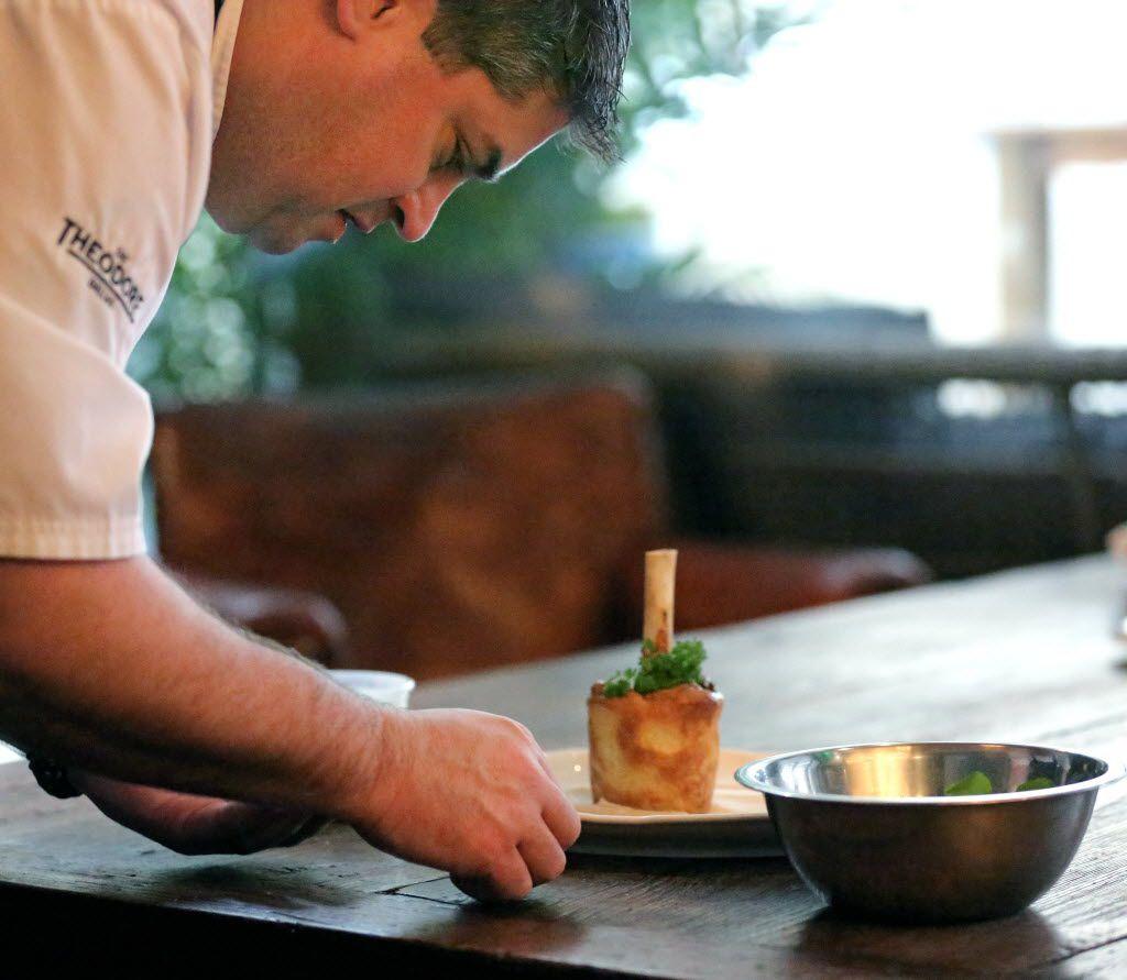 Executive chef Scott Romano plates a lamb shank.