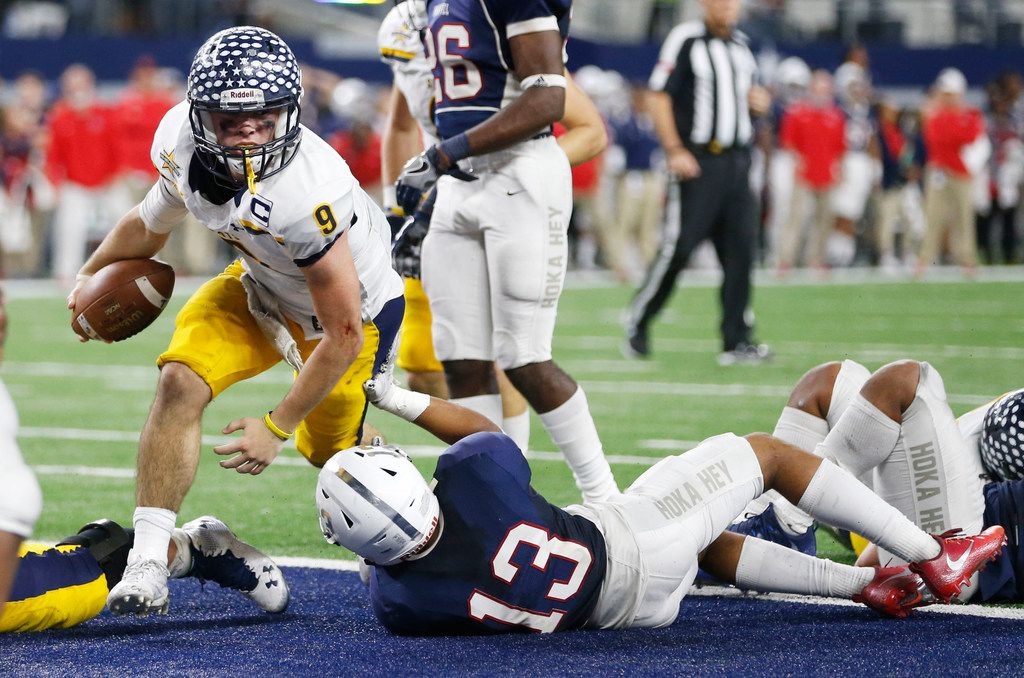 Highland Park's John Stephen Jones (9) scores a touchdown as he is tackled by Manvel's Kameron Pedescleaux (13) during the second half of play of the UIL Class 5A Division II state football championship at AT&T Stadium in Arlington, Texas on Friday, December 22, 2017. Highland Park defeated Manvel 53-49. (Vernon Bryant/The Dallas Morning News)