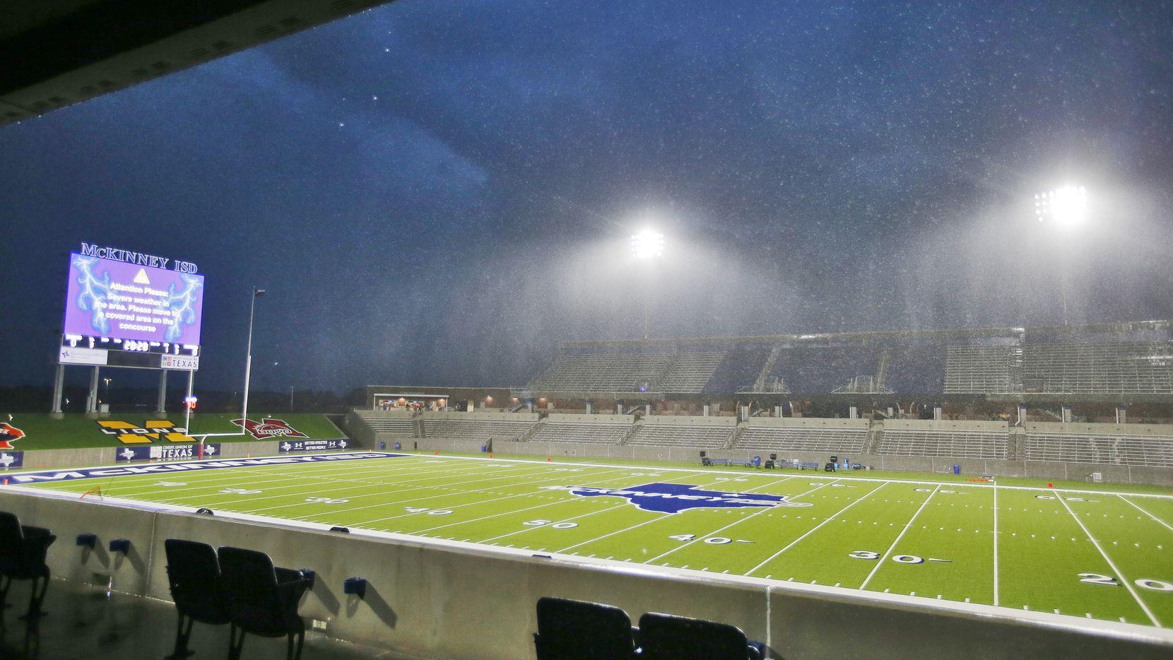 Sheets of rain came down last month during a weather delay holding up the start of a high school football game between Plano East and McKinney Boyd at McKinney ISD Stadium.