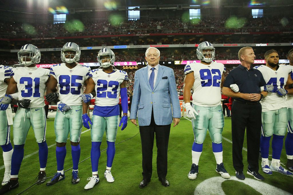 FILE - Cowboys safety Byron Jones (31), wide receiver Noah Brown (85), defensive back Bene Benwikere (23), owner Jerry Jones, defensive tackle Brian Price (92), head coach Jason Garrett and fullback Keith Smith (41) prepare for the playing of the national anthem before a game against the Arizona Cardinals at University of Phoenix Stadium in Glendale, Ariz., on Monday, Sept. 25, 2017. (Andy Jacobsohn/The Dallas Morning News)