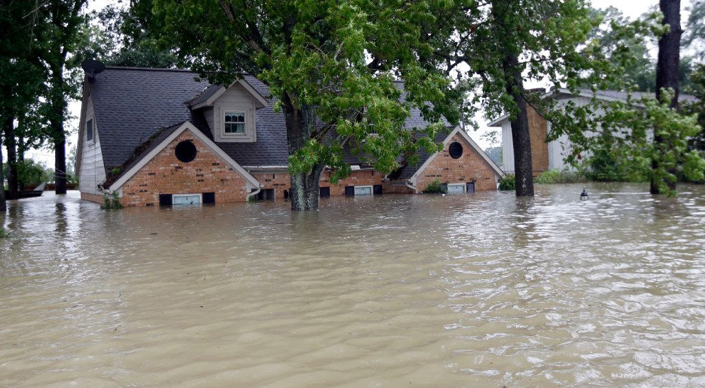 This home was surrounded by floodwaters from Harvey on Monday in Spring.(David J. Phillip/The Associated Press)