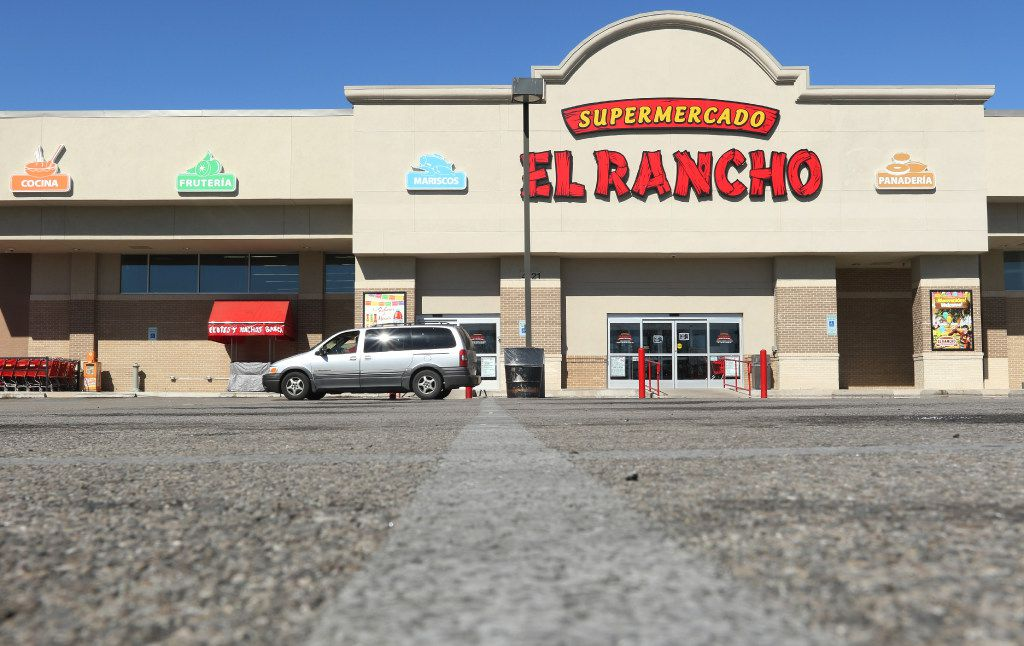 """A mini van drive across the empty parking lot, as sign, in English and Spanish, on the door of Supermercado El Rancho, on 4121 Gaston Ave, in Dallas, informs their customers that their store would be closed on Thursday, 2/16/17 in support of the """"Day Without Immigrants"""" protest. Across Dallas, the state, and nation, shops and restaurants closed in solidarity on Thursday for a """"Day Without Immigrants. (Irwin Thompson/The Dallas Morning News)"""