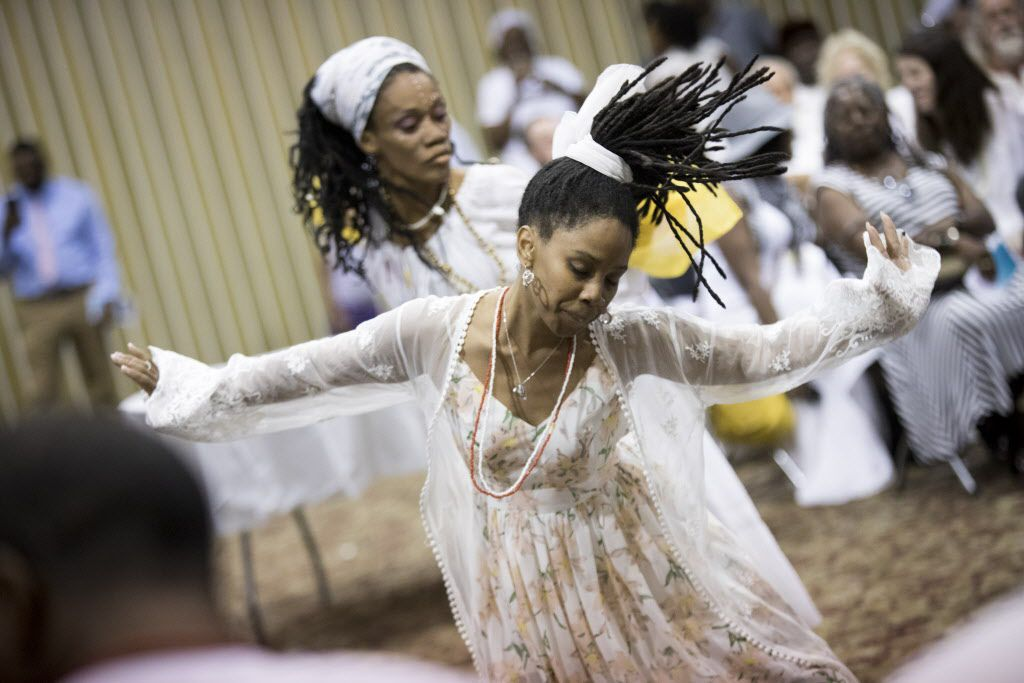 Attendees dance during a memorial service for Arthur Riggins, also affectionately known as Baba and Chief Ifayomi by the community, on May 19, 2017, at the Frederick Douglass Community Center in Dallas, Texas. Riggins was a community leader that was killed by his godson in an incident that also injured a neighbor and a Dallas firefighter-paramedic in May. (Andrew Buckley/Special Contributor)