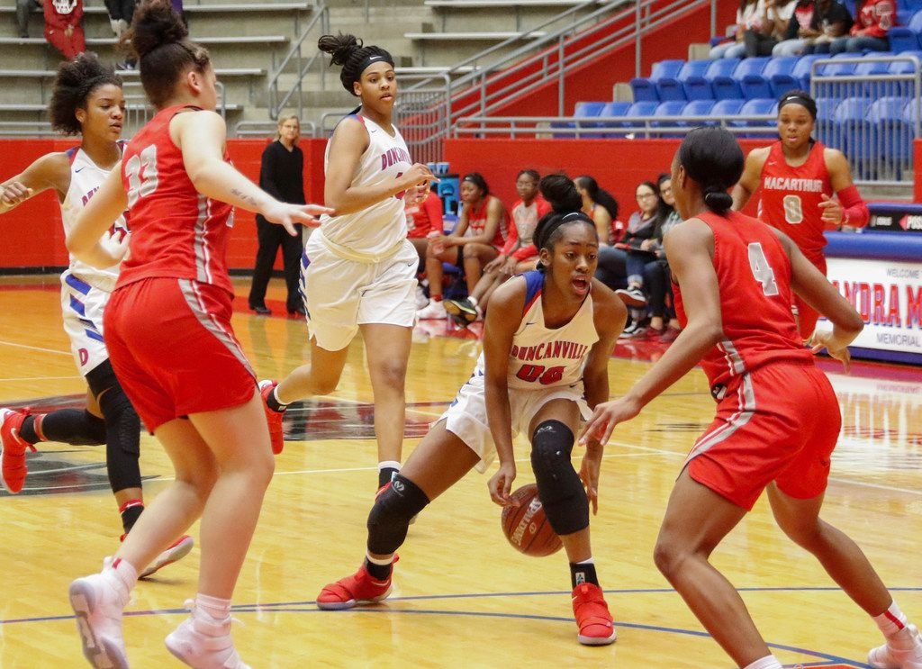 McDonald's All-American Zarielle Green (00) of Duncanville dribbles against Irving MaArthur's Karyssa Jackson (33) and Tailor Broussard (04) in District 7-6A basketball game Tuesday, January 16, 2018. (Ron Baselice/ The Dallas Morning News)