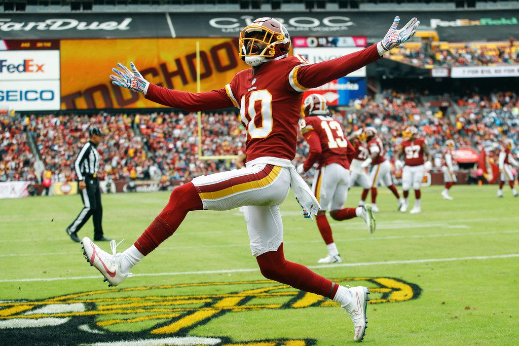 FILE- In this Oct. 14, 2018 file photo, Washington Redskins wide receiver Paul Richardson (10) celebrates his touchdown during the first half of an NFL football game against the Carolina Panthers, in Landover, Md. Both starting guards for the Washington Redskins, Brandon Scherff and Shawn Lauvao, will have season-ending surgery, as will wide receiver Richardson. Richardson has been dealing with a shoulder problem that now needs an operation. (AP Photo/Patrick Semansky, File)