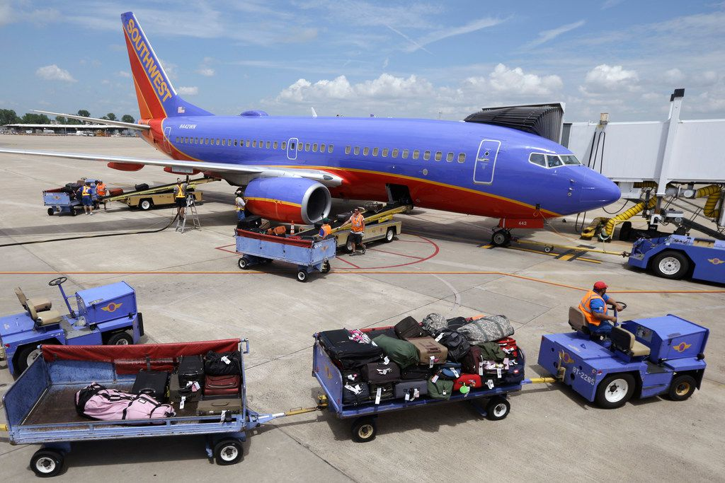 Baggage carts were towed to a Southwest Airlines jet at Bill and Hillary Clinton National Airport in Little Rock, Ark., in 2014 as the Boeing 737 was  serviced.