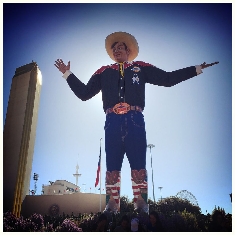 People sit at the Big Tex circle during the State Fair of Texas at Fair Park in Dallas Tuesday, Oct. 11, 2016. (Jae S. Lee/The Dallas Morning News)