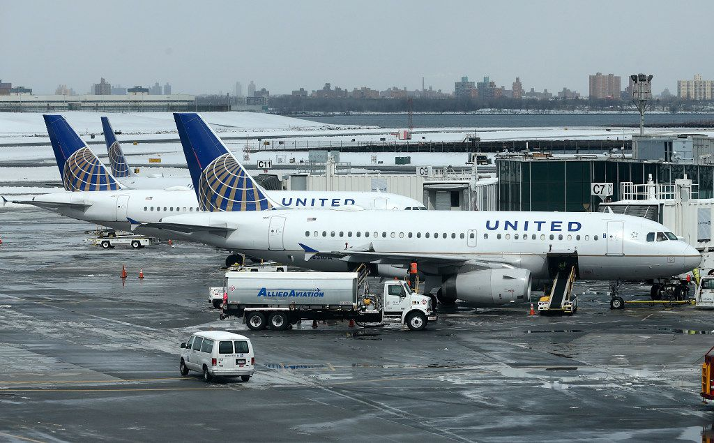 FILE - In this Wednesday, March 15, 2017, file photo, United Airlines jets sit on the tarmac at LaGuardia Airport in New York. United Continental Holdings Inc. reports quarterly financial results Monday, April 17, 2017. (AP Photo/Seth Wenig, File)