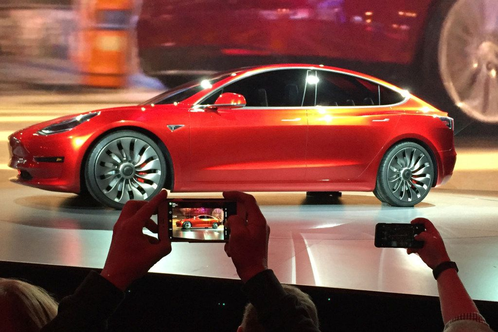 Tesla Motors unveiled the new lower-priced Model 3 sedan at the Tesla Motors design studio in Hawthorne, Calif., in March 2016. The electric car maker said Monday that the Model 3 will go on sale Friday.