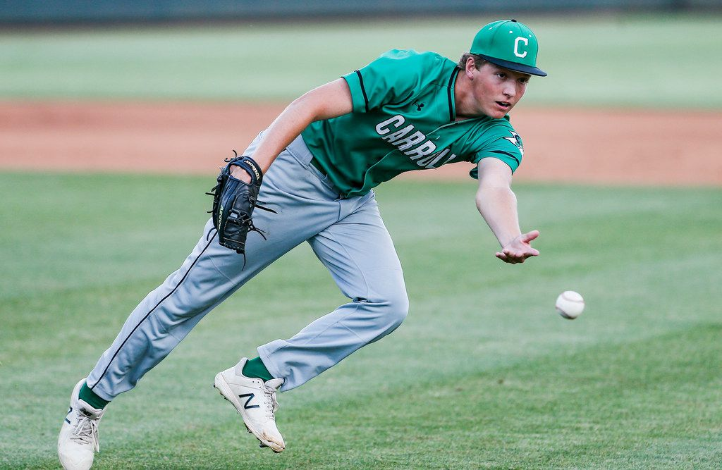 Southlake Carroll starting pitcher Cutter Sippel tosses the ball to first to force out Flower Mound's Matt Marlow during the first inning in game one of a best of three series Class 6A Region I final at TCU's Lupton Stadium in Fort Worth, Thursday, May 30, 2019. (Brandon Wade/Special Contributor)