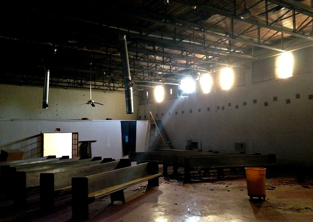 Inside the old gymnasium that, for a while, served as the main sanctuary of a church that has long since shuttered.