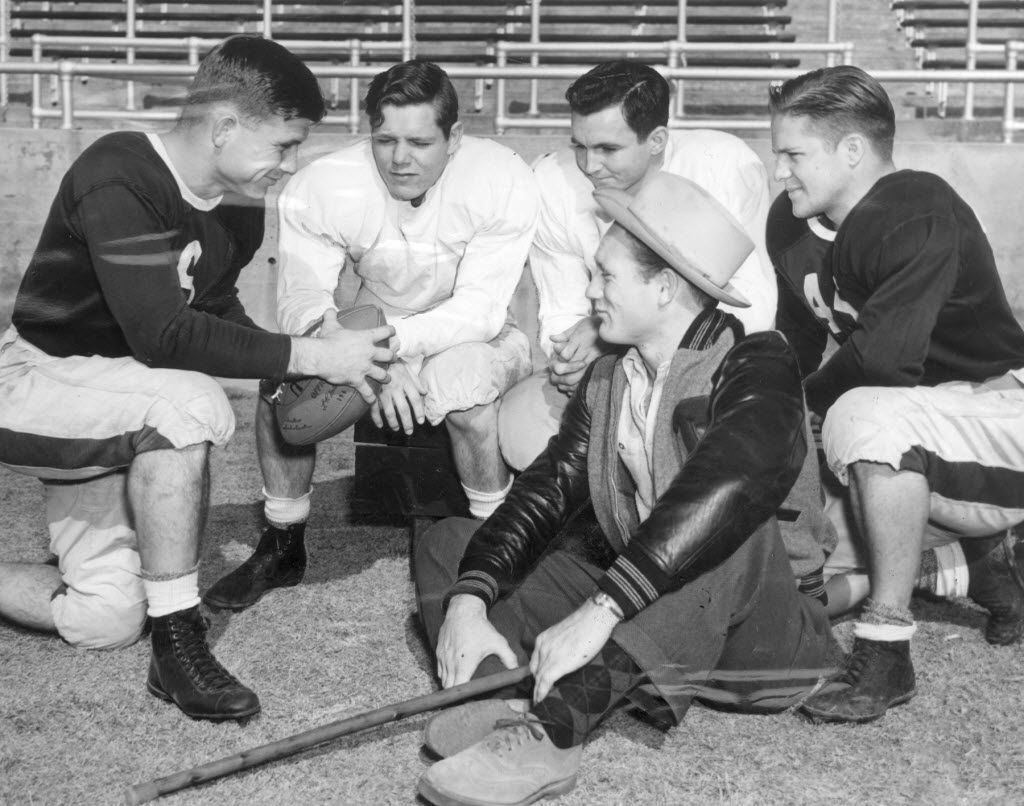 This photo provided by the University of Texas at Arlington Library shows Davey O'Brien, quarterback for Philadelphia Eagles, huddles with TCU players Danny Reese, Harmon Hightower, and Dean Bagley, with Rusty Cowart seated in front, during spring training, on Feb. 13, 1940.   Many questions of the 1940 census will be revealed April 2, when the National Archives and Records Administration makes records available from the 1940 Census.  (AP Photo/UTA Library via The Fort Worth Star-Telegram)