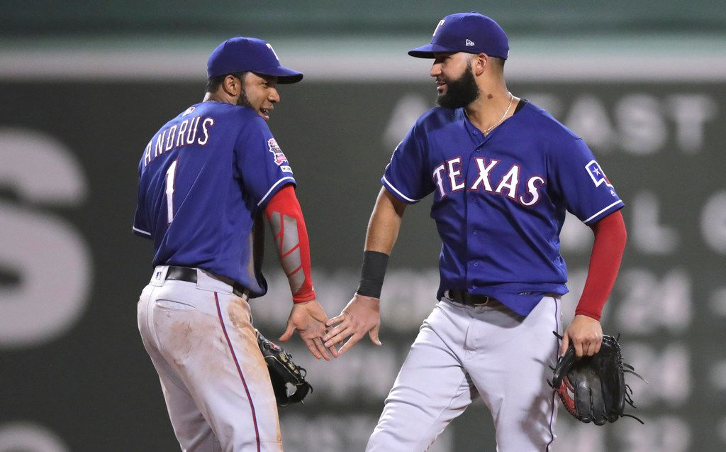 Texas Rangers' Elvis Andrus, left, and Nomar Mazara celebrate after defeating the Boston Red Sox in 11 innings during a baseball game at Fenway Park in Boston, Monday, June 10, 2019. (AP Photo/Charles Krupa)