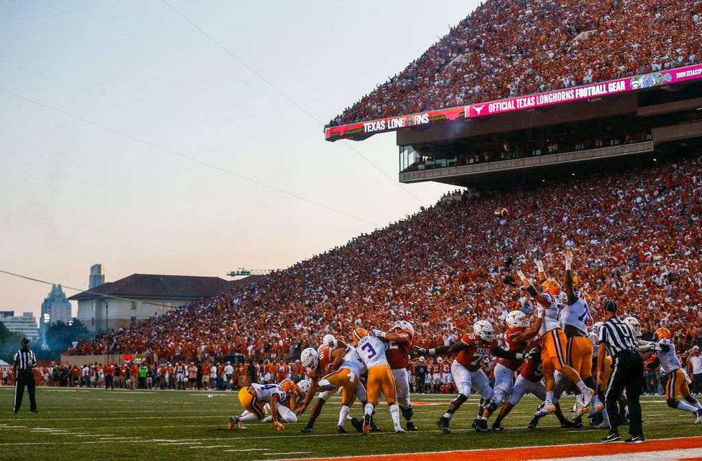 The Texas Longhorns punt for the extra point after scoring a touchdown in the second quarter of a college football game between the University of Texas and Louisiana State University on Saturday, Sept. 7, 2019 at Darrell Royal Memorial Stadium in Austin, Texas. (Ryan Michalesko/The Dallas Morning News)