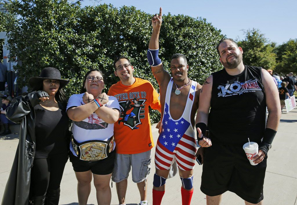 Ronyell Wilson of Houston points to the sky while posing for a group portrait before WrestleMania 32 at AT&T Stadium in Arlington, TX, Sunday, April 3, 2016. (David Guzman/The Dallas Morning News)
