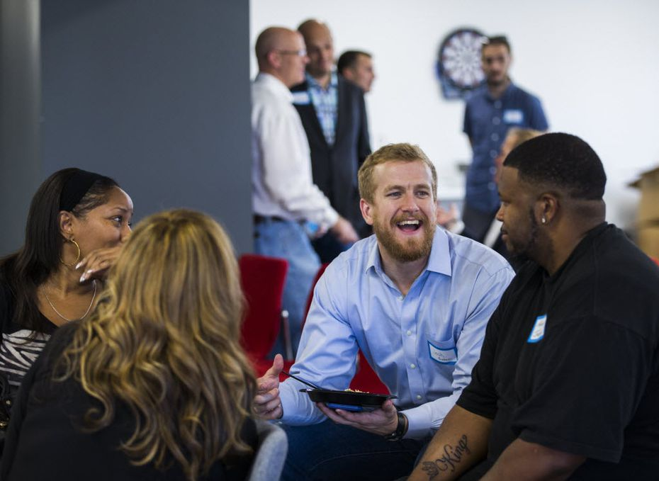 Participants chat during an event by Cornbread Hustle, a staffing agency that places released convicts. (Ashley Landis/The Dallas Morning News)