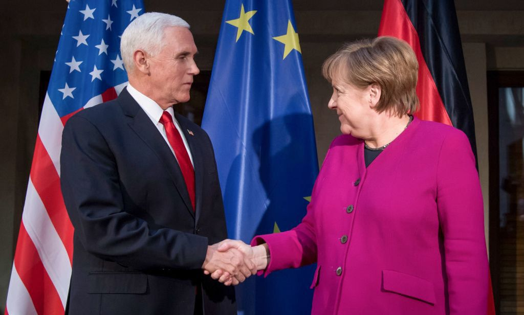 German Chancellor Angela Merkel (R) and US Vice President Mike Pence shake hands at a photo call during the 55th Munich Security Conference in Munich, Germany, on Feb. 16, 2019.
