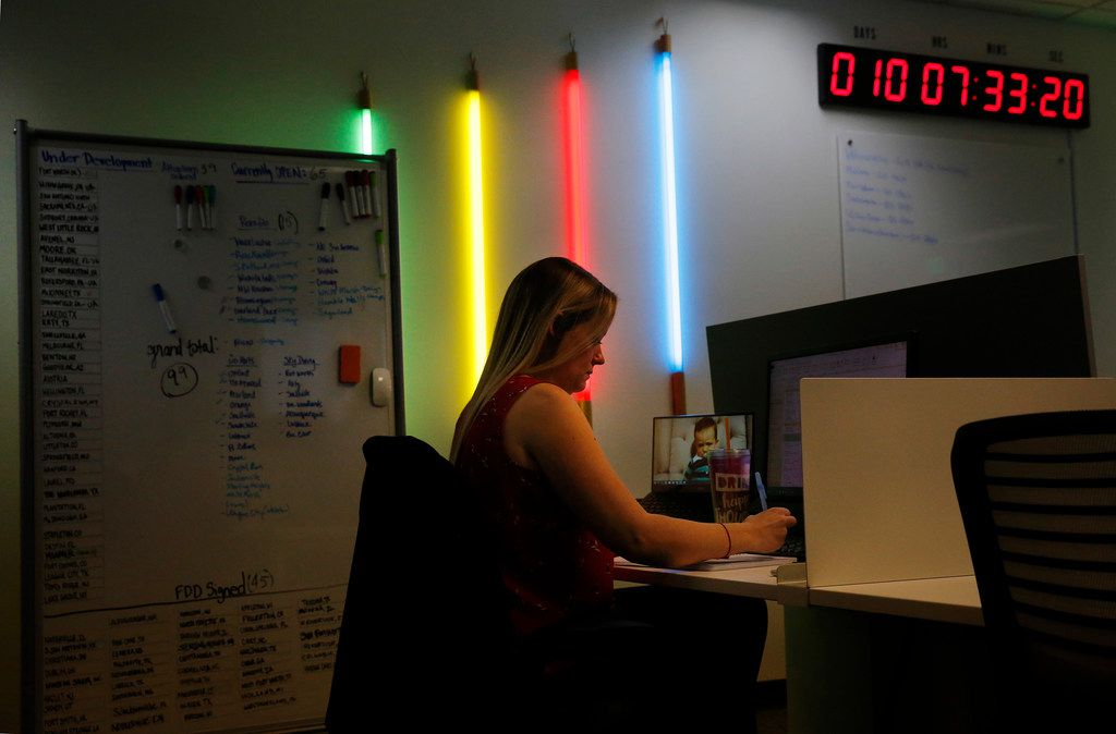 The Urban Air Adventure Park headquarters in Bedford is decorated like the entertainment venues. Their signature colored bulbs illuminate the office where director of training Jessie Schulatt works.