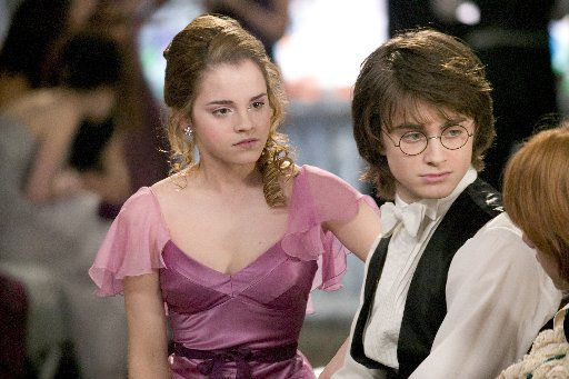"""Organizers hope Wizardfest attendees are happier at the party than EMMA WATSON as Hermione Granger and DANIEL RADCLIFFE as Harry Potter were at their ball in """"Harry Potter and the Goblet of Fire."""""""